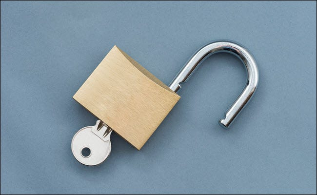 An open padlock with key inserted.