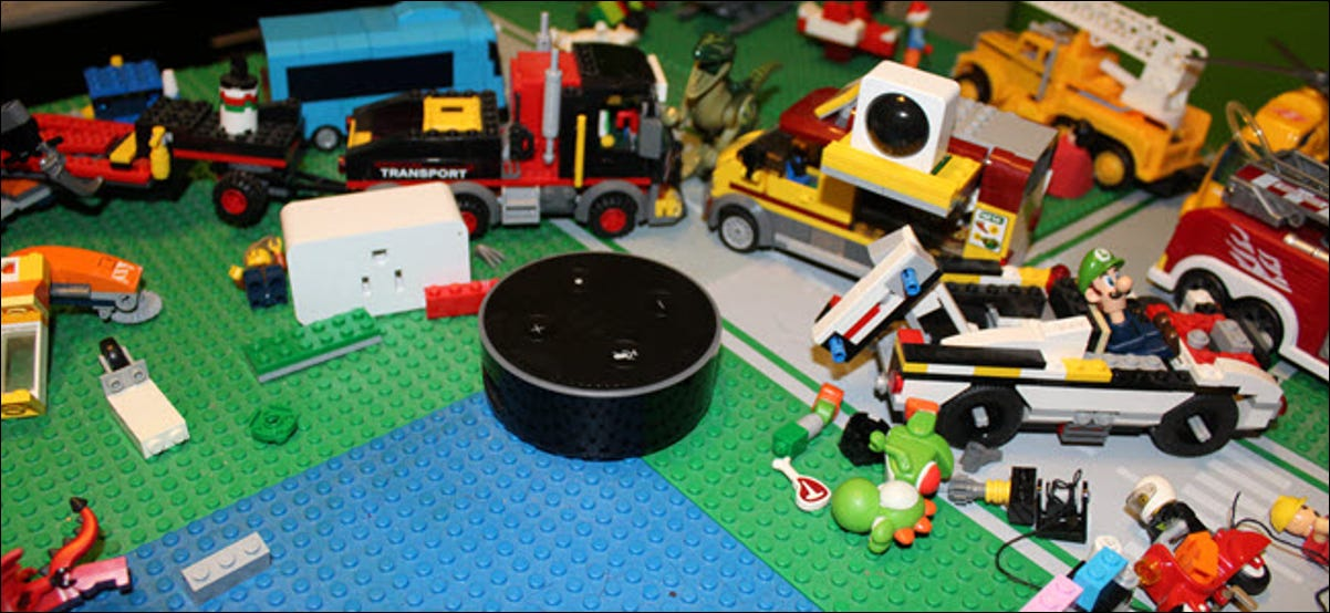 A smart plug, IR sensor, and Echo in the midst of Lego blocks and other toys.